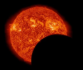 moon crossing in front of the sun nasa   v2
